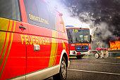 German firefighting trucks stands on a fire