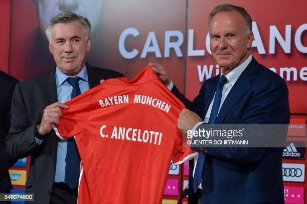 German first division Bundesliga club Bayern Munich's new head coach Carlo Ancelotti holds a football jersey with his name as he poses with the...