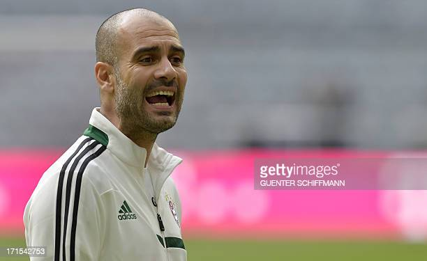 German first division Bundesliga football club Bayern Munich's new head coach Pep Guardiola talks with his players during the first training session...