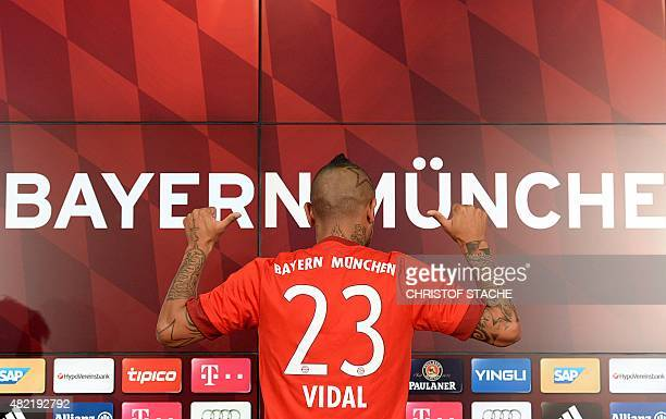German first division Bundesliga football club Bayern Munich's new recruit Chilean midfielder Arturo Vidal shows his jersey during a press conference...