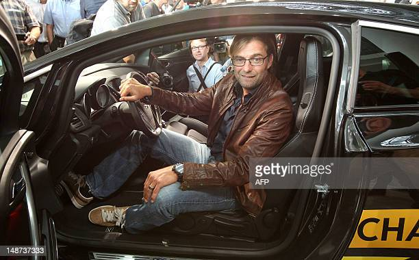 German first division Bundesliga football club Dortmund's head coach Juergen Klopp arrives at a joint press conference with German car maker Opel at...