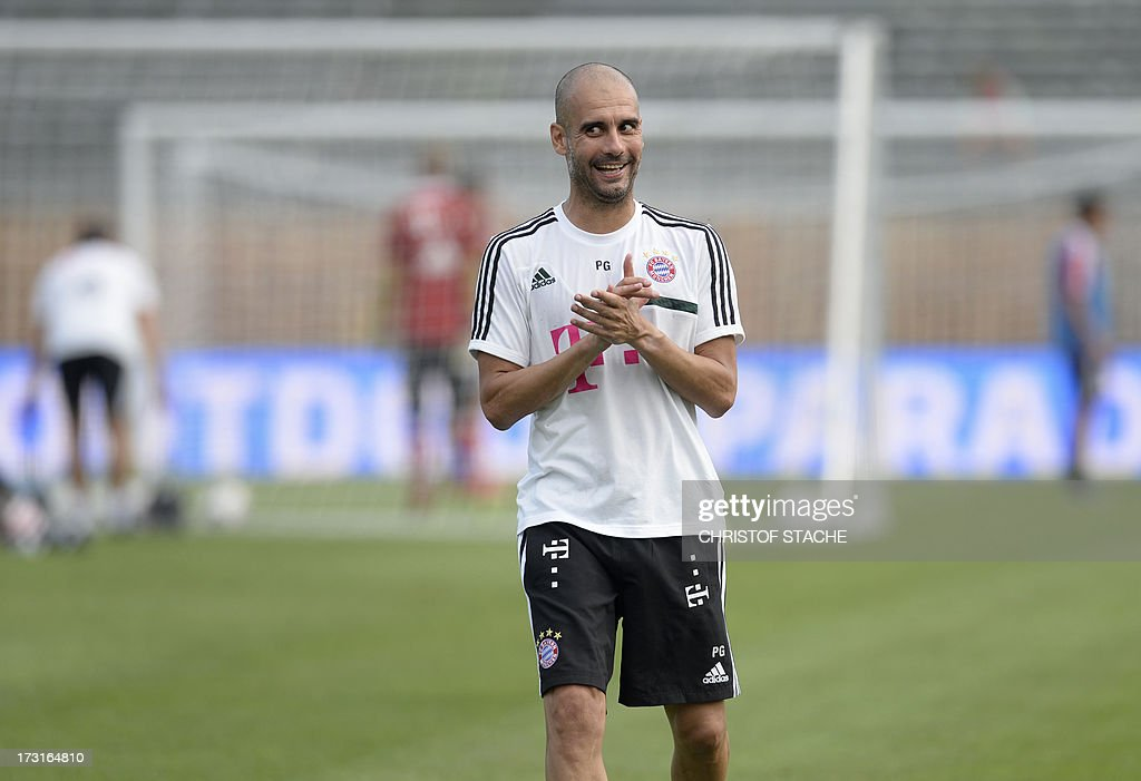 German first division Bundesliga football club FC Bayern Munich's Spanish head coach Pep Guardiola reacts during a training session at the team's summer training camp in Arco, Itlay, on July 8, 2013. AFP PHOTO/CHRISTOF STACHE