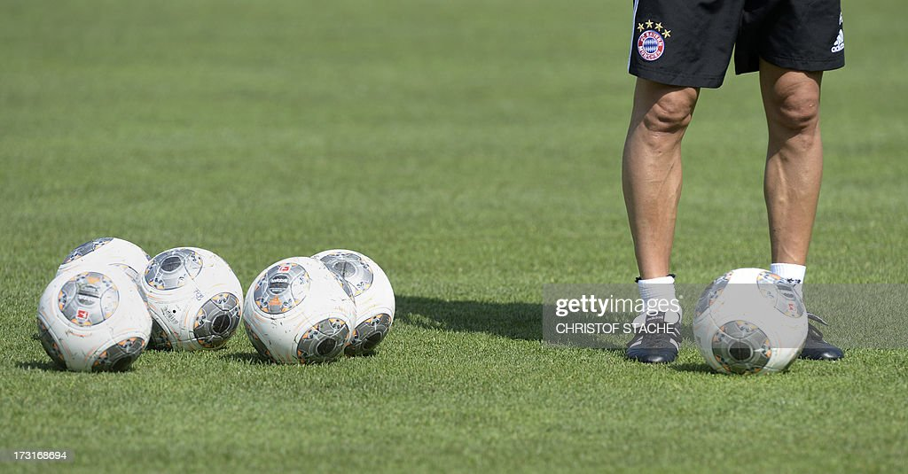 German first division Bundesliga football club FC Bayern Munich's Spanish head coach Pep Guardiola stands on the pitch during a training session at the team's summer training camp in Arco, Italy, on July 9, 2013.