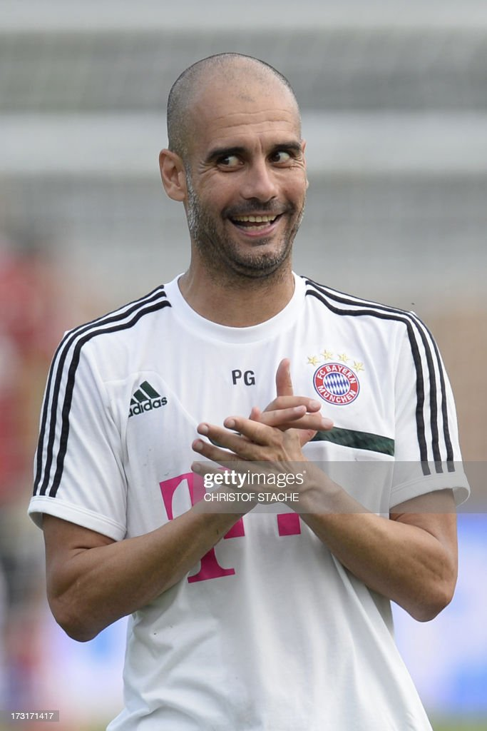 German first division Bundesliga football club FC Bayern Munich's Spanish head coach Pep Guardiola reacts during a training session at the team's summer training camp in Arco, Itlay, on July 8, 2013.