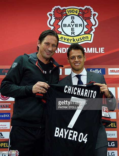 German first division Bundesliga team Bayer 04 Leverkusen's new Mexican forward Javier 'Chicharito' Hernandez and Leverkusen´s headcoach Roger...