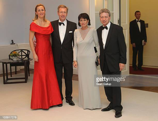 German First Lady Bettina Wulff German President Christian Wulff Swiss President Doris Leuthard and her husband Roland Hausin attend a state banquet...