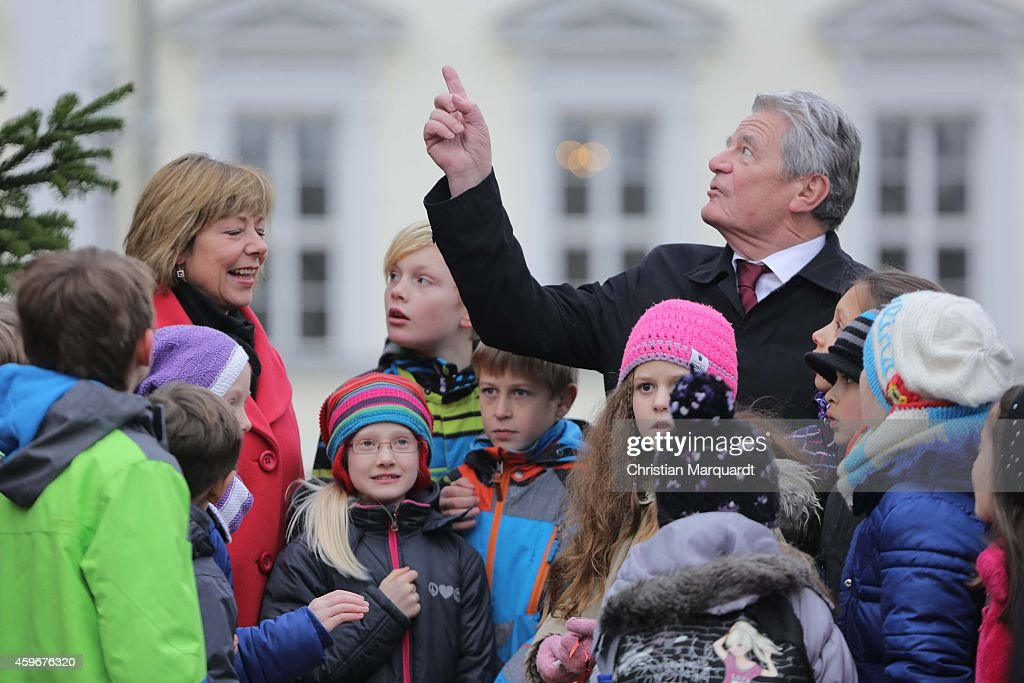 German First Lady Daniela Schadt and German President Joachim Gauck attend the christmas tree lighting ceremony at Bellevue Palace on November 28, 2014 in Berlin, Germany. Every year Mr Gauck and Ms Schadt welcome children to the traditional ceremony as part of the Christmas festivities.