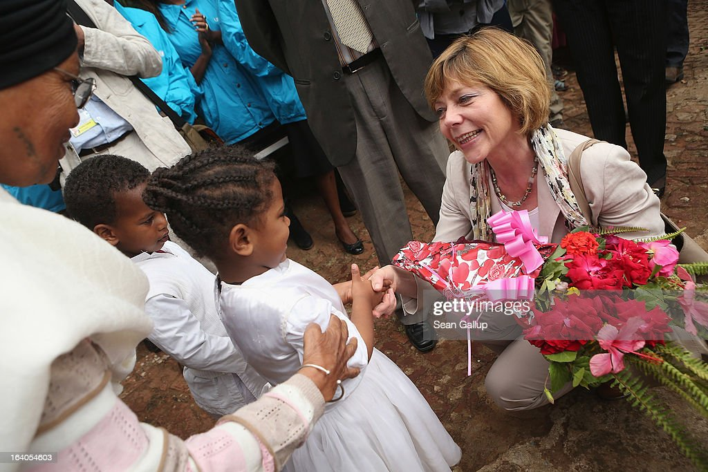 German First Lady <a gi-track='captionPersonalityLinkClicked' href=/galleries/search?phrase=Daniela+Schadt&family=editorial&specificpeople=7055235 ng-click='$event.stopPropagation()'>Daniela Schadt</a> greets children upon her arrival at the AGOHELD orphanage, hospital, training center and school as founder Abebech Gobena (L) looks on on March 19, 2013 in Addis Ababa, Ethiopia. Ababech Gobena started the orphanage in 1980 and has since received help from both Ethiopian and international organizations, especially UNICEF, to expand the project to communities across Ethiopia. German President Joachim Gauck and First Lady <a gi-track='captionPersonalityLinkClicked' href=/galleries/search?phrase=Daniela+Schadt&family=editorial&specificpeople=7055235 ng-click='$event.stopPropagation()'>Daniela Schadt</a> are on the third of a four-day state visit to Ethiopia.