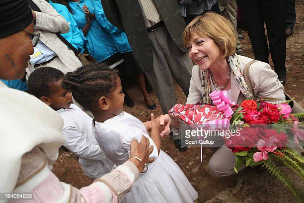 German First Lady Daniela Schadt greets children upon her arrival at the AGOHELD orphanage hospital training center and school as founder Abebech...