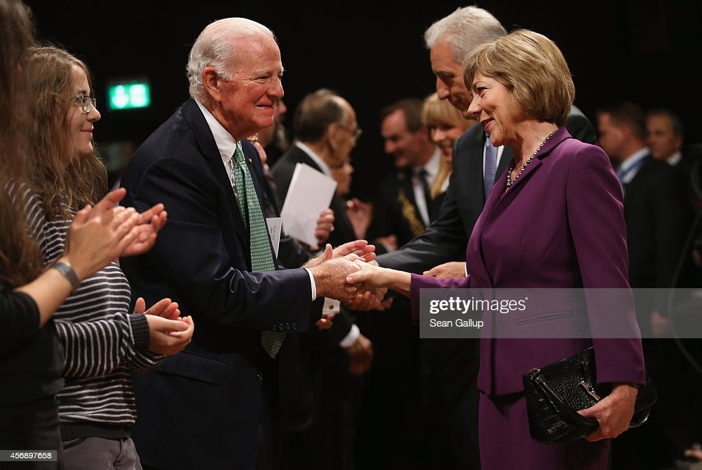 German First Lady Daniela Schadt (R) greets former U.S. Secretary of State James Baker at the Gewandhaus concert hall prior to commemorations marking the 25th anniversary of the mass protests in Leipzig that preceded the fall of the communist government of East Germany on October 9, 2014 in Leipzig, Germany. On October 9, 1989, following weeks of protests that had resulted in beatings and arrests by police, 70,000 protesters demanding greater freedom marched unopposed through the city in a historic event that signaled the beginning of the end of the communist government's authority. Only a month later the infamous Berlin Wall fell, breaking the near isolation of East Germans under communist dictatorship. Revolutions continued to sweep across Eastern Europe and within months all of the communist governments collapsed.