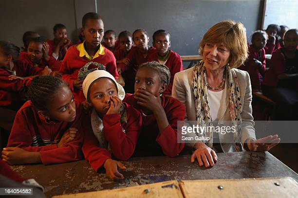 German First Lady Daniela Schadt sits among sixth and seventh grade schoolchildren during a visit to the AGOHELD orphanage hospital training center...