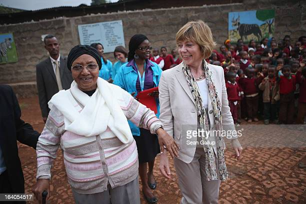 German First Lady Daniela Schadt walks with Abebech Gobena founder of the AGOHELD orphanage hospital training center and school during a visit to...