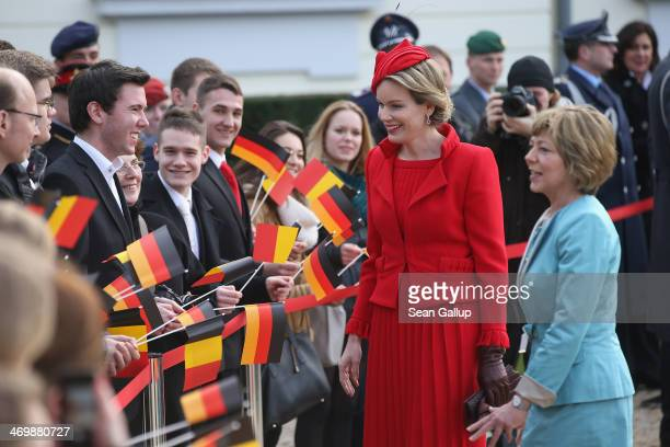 German First Lady Daniella Schadt and Queen Mathilde of Belgium greet school children outside Schloss Bellevue on February 17 2014 in Berlin Germany...