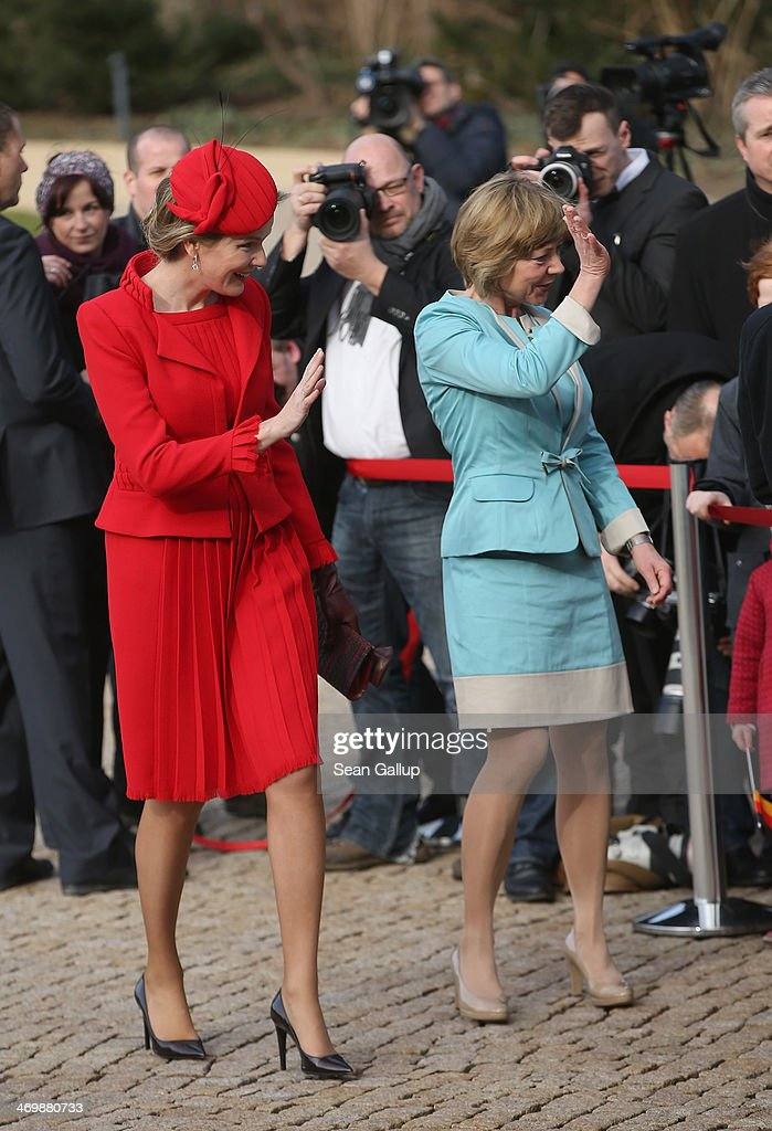 German First Lady Daniella Schadt (R) and Queen Mathilde of Belgium greet visitors outside Schloss Bellevue on February 17, 2014 in Berlin, Germany. King Philippe and Queen Mathilde are in Berlin to attend a German-Belgian conference.