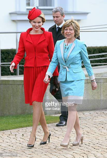 German First Lady Daniella Schadt and Queen Mathilde of Belgium prepare to greet visitors outside Schloss Bellevue on February 17 2014 in Berlin...