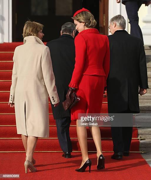 German First Lady Daniella Schadt and Queen Mathilde of Belgium walk toward Schloss Bellevue with King Philippe of Belgium and German President...