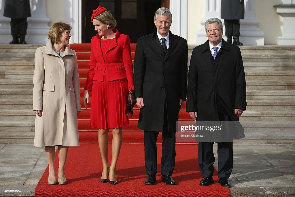 German First Lady Daniella Schadt, <a gi-track='captionPersonalityLinkClicked' href=/galleries/search?phrase=Queen+Mathilde+of+Belgium&family=editorial&specificpeople=239189 ng-click='$event.stopPropagation()'>Queen Mathilde of Belgium</a>, King <a gi-track='captionPersonalityLinkClicked' href=/galleries/search?phrase=Philippe+of+Belgium&family=editorial&specificpeople=160209 ng-click='$event.stopPropagation()'>Philippe of Belgium</a> and German President <a gi-track='captionPersonalityLinkClicked' href=/galleries/search?phrase=Joachim+Gauck&family=editorial&specificpeople=2077888 ng-click='$event.stopPropagation()'>Joachim Gauck</a> pose briefly for the media upon the Belgian royal couple's arrival at Schloss Bellevue on February 17, 2014 in Berlin, Germany. King Philippe and Queen Mathile are in berlin to attend a German-Belgian conference.