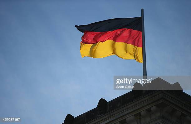 German flag flies over the Reichstag on the day Angela Merkel Chancellor and Chairwoman of the German Christian Democrats Horst Seehofer Chairman of...