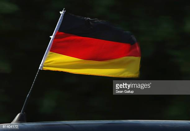 German flag flutters on top of a car driving in the city center on June 4 2008 in Berlin Germany Many German soccer fans are showing their dedication...