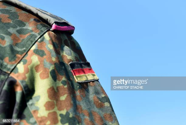 A German flag is seen at a uniform of a German soldier during the exercise 'Strong Europe Tank Challenge 2017' at the exercise area in Grafenwoehr...