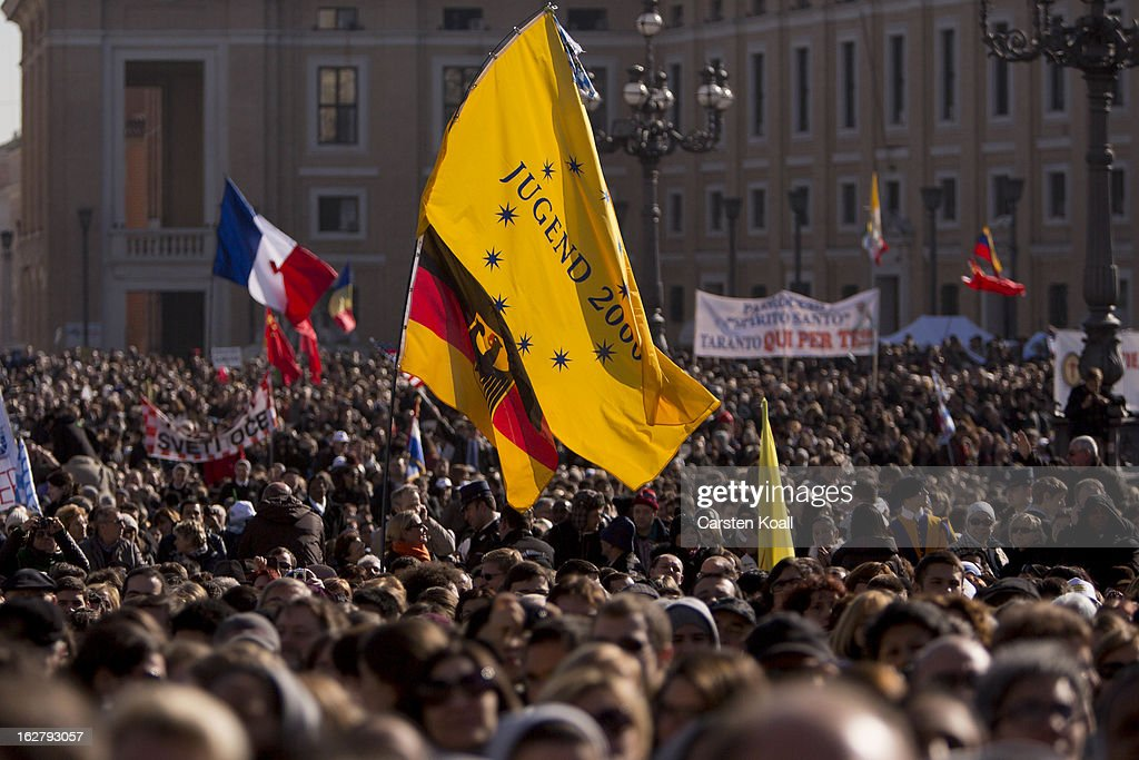 A german flag is waved as the crowd waits for the arrival of Pope Benedict XV in St Peter's Square on February 27, 2013 in Vatican City, Vatican. The Pontiff will hold his last weekly public audience later before he abdicates tomorrow. Pope Benedict XVI has been the leader of the Catholic Church for eight years and is the first Pope to retire since 1415. He cites ailing health as his reason for retirement and will spend the rest of his life in solitude away from public engagements.