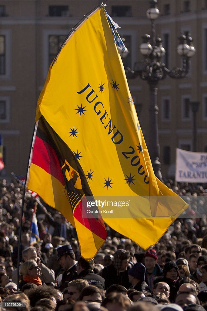 A german flag is waved as the crowd waits for the arrival of Pope Benedict XV in St Peter's Square on February 27, 2013 in Vatican City, Vatican.The Pontiff will hold his last weekly public audience later before he abdicates tomorrow. Pope Benedict XVI has been the leader of the Catholic Church for eight years and is the first Pope to retire since 1415. He cites ailing health as his reason for retirement and will spend the rest of his life in solitude away from public engagements.