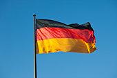 A German flag on a flag pole