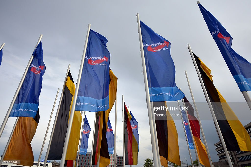 German flags and flags of the 'Alternative fuer Deutschland' (AfD) party's pictured at the party federal congress at the Congress Centre (ICS) on April 30, 2016 in Stuttgart, Germany. The AfD, a relative newcomer to the German political landscape, has emerged from Euro-sceptic conservatism towards a more right-wing leaning appeal based in large part on opposition to Germany's generous refugees and migrants policy. Since winning seats in March elections in three German state parliaments the party has sharpened its tone, calling for a ban on minarets and claiming that Islam does not belong in Germany.
