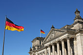 closeup of German flags and Reichstag building in Berlin, Germany
