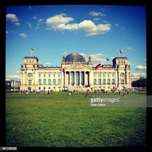 German flags fly over the Reichstag on April 28 2014 in Berlin Germany The Reichstag home of the Bundestag the German parliament is among the city's...