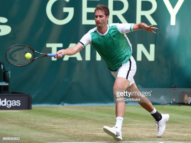German Florian Mayer in action against French Lucas Pouille during the ATP tournament tennis match in Halle western Germany on June 22 2017 / AFP...