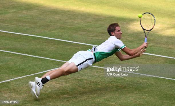 German Florian Mayer plays against French Lucas Pouille during the ATP tournament tennis match in Halle western Germany on June 22 2017 / AFP PHOTO /...
