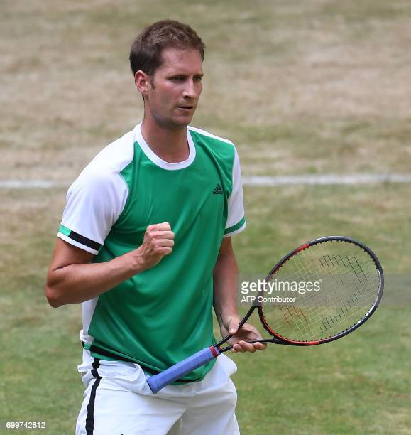 German Florian Mayer reacts as he plays against French Lucas Pouille during the ATP tournament tennis match in Halle western Germany on June 22 2017...
