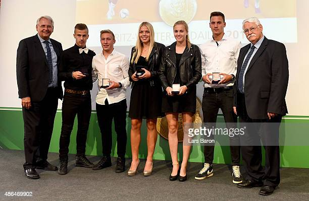 German Football Association DFB VicePresident for Youth Football HansDieter Drewitz poses with U17 silver medal winner Niklas Dorsch U17 gold medal...