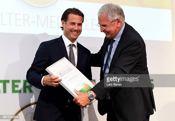 German Football Association DFB VicePresident for Youth Football HansDieter Drewitz smiles with Lars Ricken during the Fritz Walter Medal Awarding...