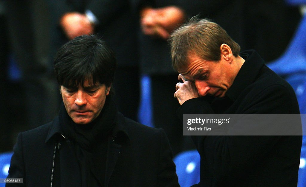 German football national team head coach <a gi-track='captionPersonalityLinkClicked' href=/galleries/search?phrase=Joachim+Loew&family=editorial&specificpeople=215315 ng-click='$event.stopPropagation()'>Joachim Loew</a> (L) and former head coach Juergen Klinsmann are seen during Robert Enke's memorial service prior to Enke�s funeral at AWD Arena on November 15, 2009 in Hanover, Germany. Tens of thousands of fans paid their last tribute to Enke, who was also goalie for the German national team, following Enke�s suicide on November 10.