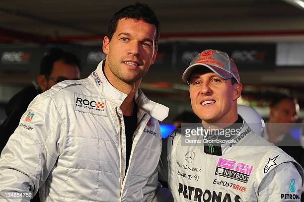German football player Michael Ballack of Bayer 04 Leverkusen and formula one driver Michael Schumacher pose during day two of the race of champions...