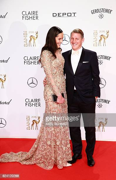 German football star Bastian Schweinsteiger and his wife Serbian tennis player Ana Ivanovic pose for photographers as they attend the Bambi awards on...