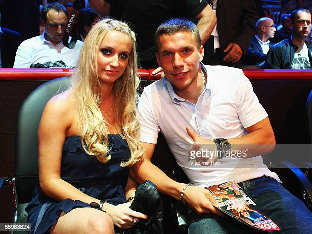German football star Lukas Podolski poses for a photo with his girlfriend Monika Puchalski ahead to the WBA Middleweight World Championship fight...