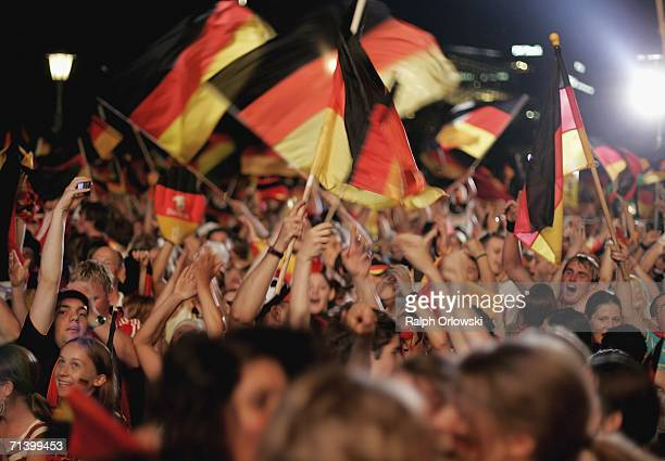 German football supporters celebrate a goal of their team at a public viewing area on July 8 2006 in Stuttgart Germany Today Germany plays against...