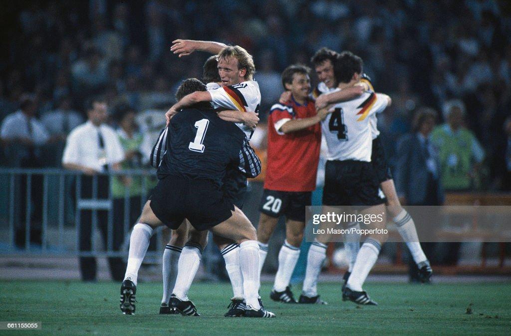 German footballer Andreas Brehme celebrates with goalkeeper Bodo Illgner as Jurgen Kohler hugs Lothar Matthaus and substitute Olaf Thon after West...