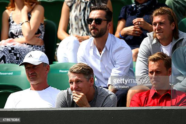 German footballer Bastian Schweinsteiger looks on as Ana Ivanovic of Serbia plays in her Ladies's Singles first round match against YiFan Xu of China...