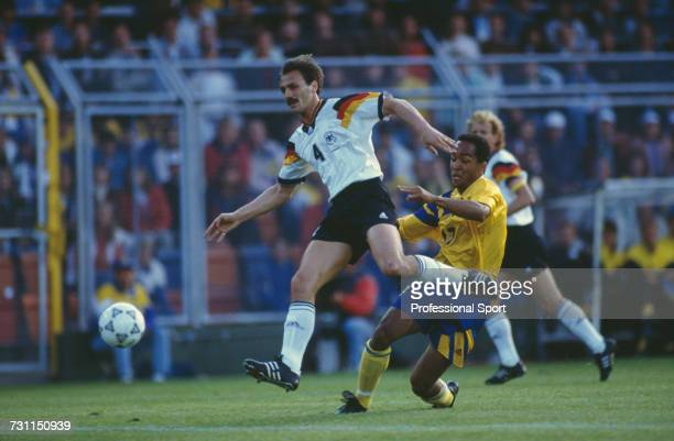 German footballer Jurgen Kohler manages to halt a run by Martin Dahlin of Sweden in the semifinal match between Sweden and Germany in the UEFA Euro...