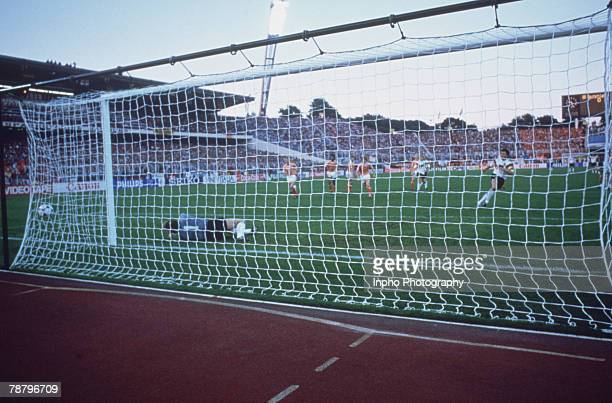 German footballer Lothar Matthaus scores a penalty in the 55th minute of a semifinal match against Holland in the UEFA European Football Championship...
