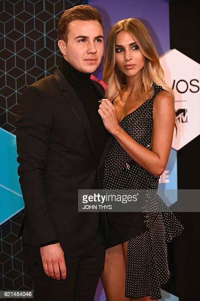 German footballer Mario Gotze and model AnnKathrin Brommel pose on the red carpet at the MTV Europe Music Awards on November 6 2016 at the Ahoy...