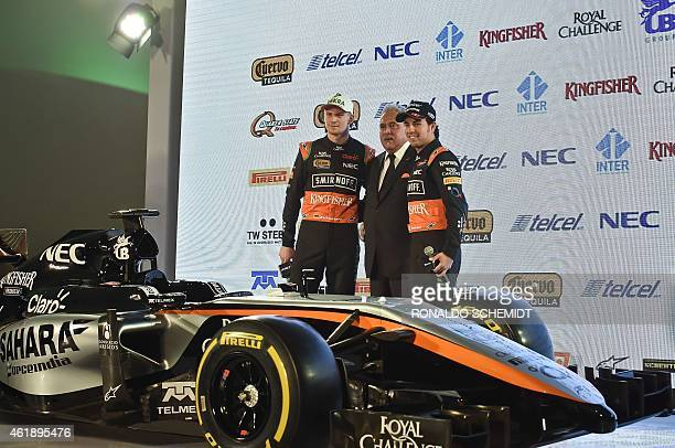 German Force India driver Nico Hülkenberg Force India Chairman Vijay Mallya and Mexican Force India driver Sergio Perez pose next to a Force India...