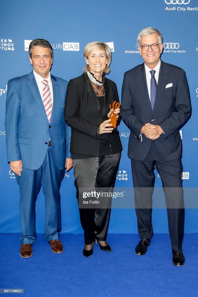 German foreign minister and award winner for inspitarion Sigmar Gabriel with Karola Wille (MDR) and Thomas Bellut (ZDF) during the 6th German Actor Award Ceremony (Deutscher Schauspielerpreis) at Zoo Palast on September 22, 2017 in Berlin, Germany.