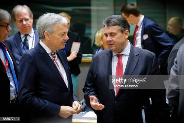 German Foreign Minister and Vice Chancellor Sigmar Gabriel and Belgium's Foreign Minister Didier Reynders chats before an EU foreign ministers...