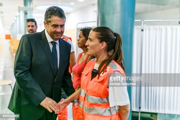 German Foreign Minister and Vice Chancellor Sigmar Gabriel meets with resue workers at Hospital Del Mar during his visit to Barcelona afterThursday's...