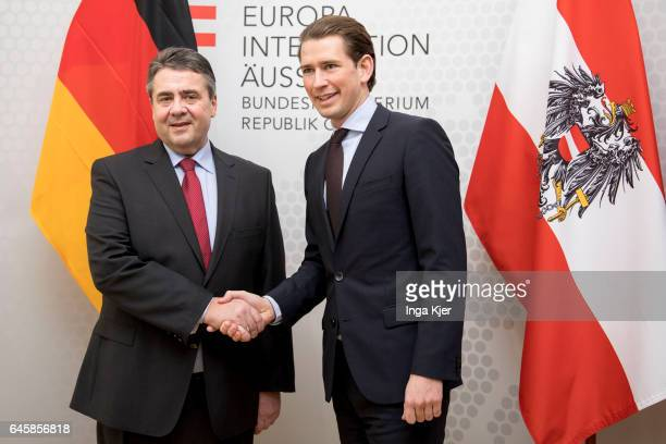 German Foreign Minister and Vice Chancellor Sigmar Gabriel shakes hands with Austrian Foreign Minister Sebastian Kurz on February 27 2017 in Vienna...